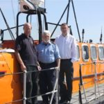 Bruce Docherty (middle), the CLI engineer, stands with representatives of the RNLI in Poole, UK prior to departing for Vlissingen, NL