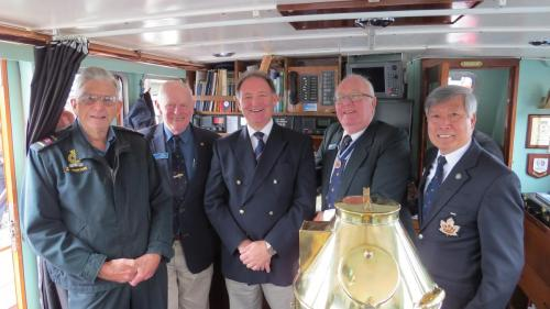 Commodore Quinn with John Horton, Bob McIlwaine, Brian Cook and a CLI supporter Commander King Wan
